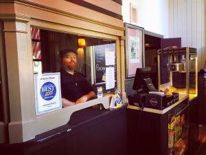 Dustin Trost stands inside the box office. Photo credit: Natalie Weintraub